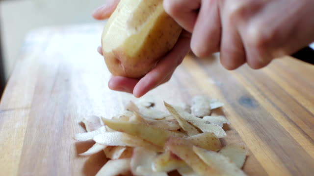 peeling potatoes Chef peeling potatoes prepared potato stock videos & royalty-free footage