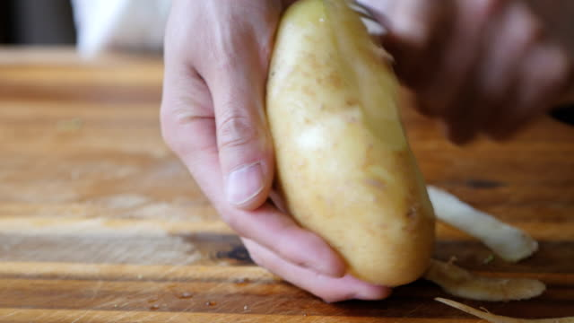 peeling potatoes close up shot Chef peeling potatoes prepared potato stock videos & royalty-free footage