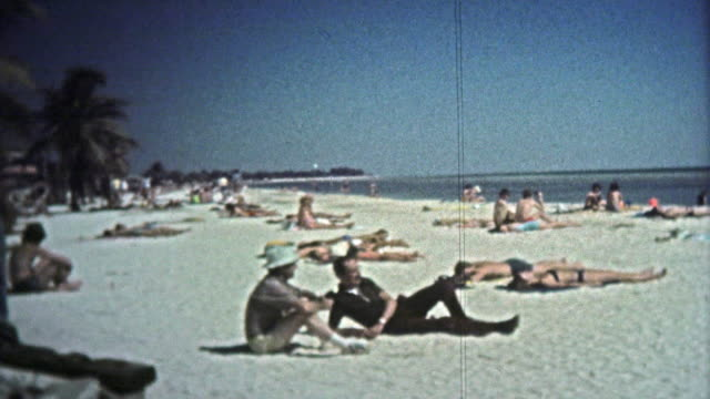 1972: Peeping tom at the beach zooms in on pretty women. video