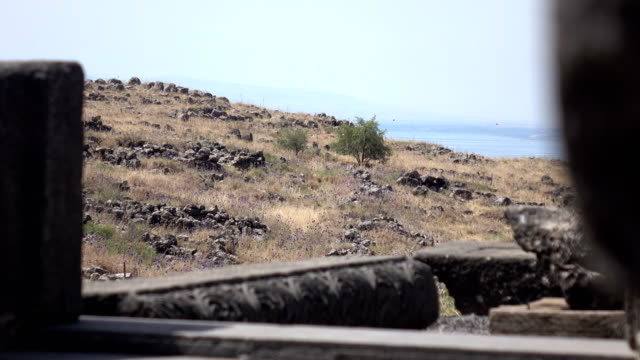 Peering Through Ruins of Ancient Temple at Barren Field in Distance video