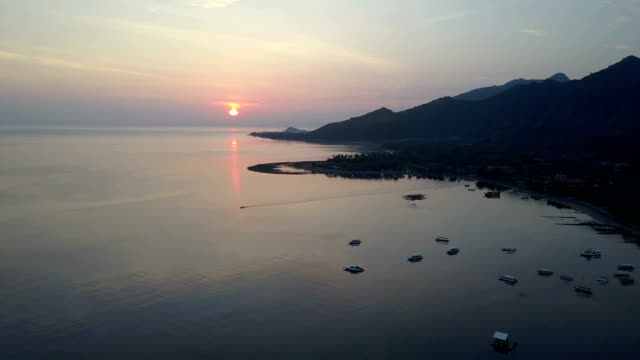 Pemuteran,Aerial view from drone,Stony seacoast and mountains on a sunset. Indonesia. Bali. video