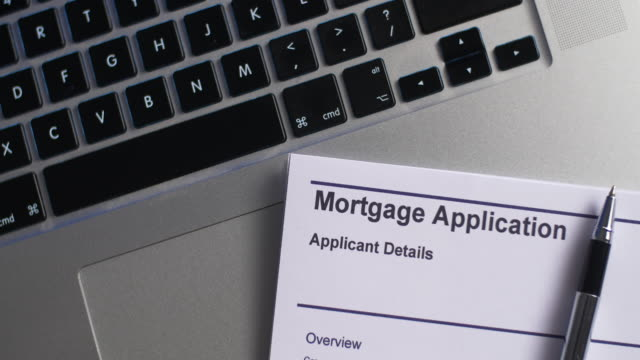 Pen placed with Mortgage Application form on desk. 4K Resolution mortgages and loans stock videos & royalty-free footage