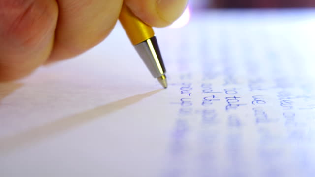 Pen writes a letter on paper