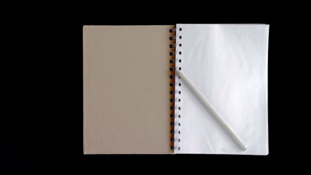 Pencil on The Book with blank pages,Dolly Shot video