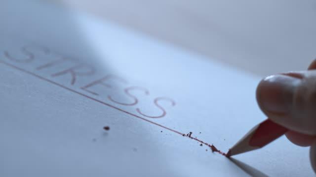 SLO MO LD Pencil tip breaking next to an inscription