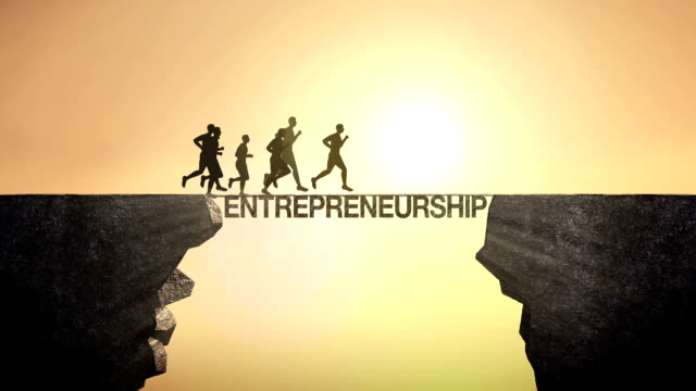 Pencil write 'Entrepreneurship', connecting the cliff. Businessman crossing the cliff.