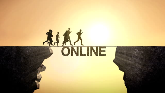 Pencil write 'Online', connecting the cliff. Businessman crossing the cliff.