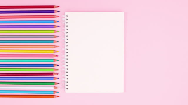 Pencils in different colors appear on left side of pastel pink theme. Stop motion