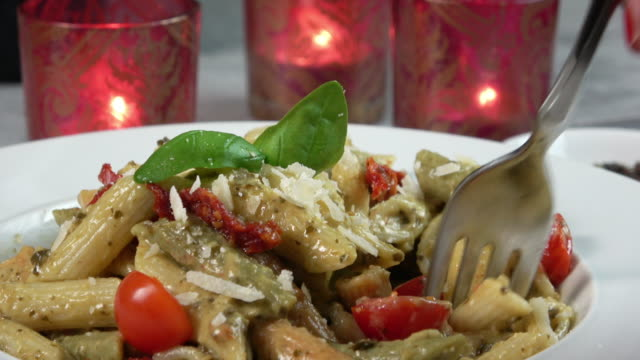 Penne Pasta Plate Fork Eating Penne Pasta Spaghetti pesto sauce stock videos & royalty-free footage