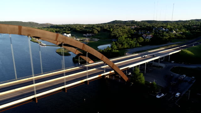Pennybacker Bridge Aerial View in Austin , Texas camera turning from Austin skyline across to bridge