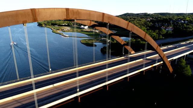 Pennybacker Bridge landmark suspension bridge Aerial View in Austin , Texas side pan close to cars passing over the suspension bridge