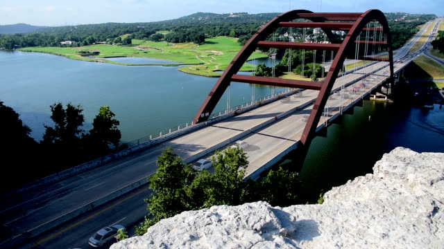 Pennybacker Bridge or 360 Bridge Long Highway angle to Corner with boats and traffic and golf course