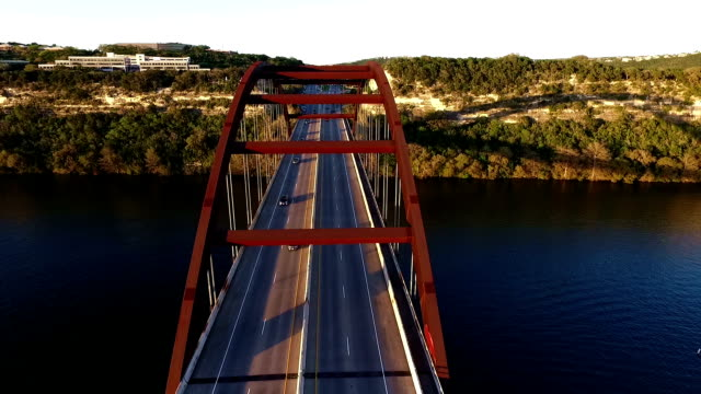 Pennybacker Bridge or 360 Bridge or Capital of Texas Highway Bridge at Sunset on the Colorado River or Town Lake Spring Time Aerial Flying Directly Over the Top of the Bridge video