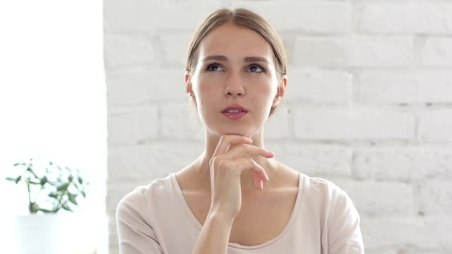 Pensive Beautiful Young Woman Thinking about Work, Brainstorming video