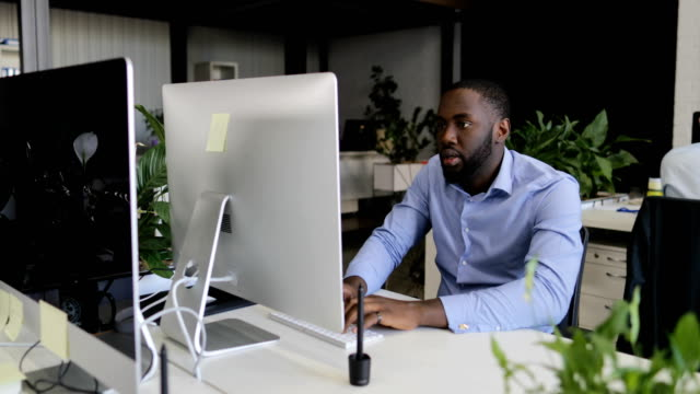 Pensive Businessman Using Computer Gets Success Excited Winning, Happy African American Business Man Cheering With Businesspeople Team In Modern Office video