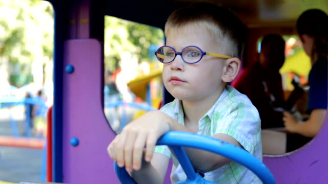 Pensive child on the playground Сhild on the playground autism stock videos & royalty-free footage