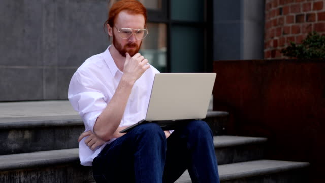 Pensive Designer Thinking while Working on Laptop Sitting near Window Pensive Designer Thinking while Working on Laptop Sitting near Window redhead stock videos & royalty-free footage