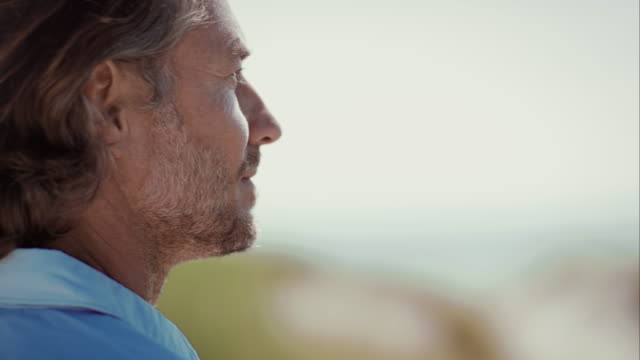 Pensive man at beach looking into distance video