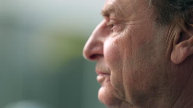 Pensive retired senior man portrait in contemplation