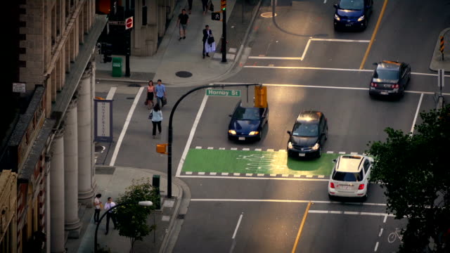 People And Cars Crossing Intersection Timelapse video