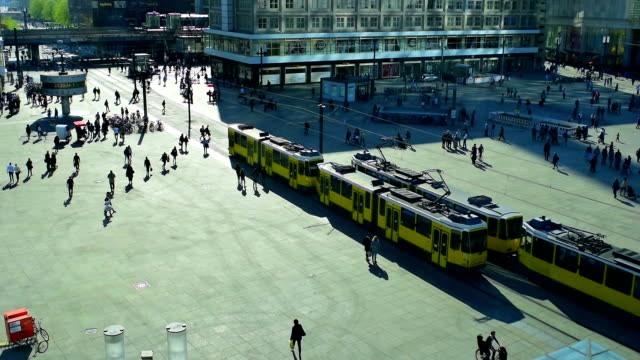 People and trams at the Alexanderplatz in Berlin video