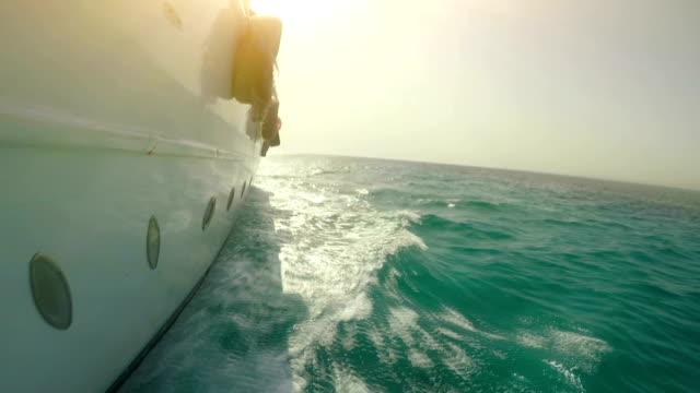 people are having fun on the luxury yacht at sea - ibiza filmów i materiałów b-roll