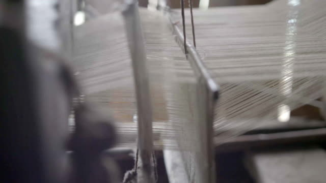 People are silk weaving in China video