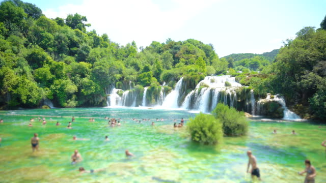 People are swimming in the waterfall in KRKA national park, Croatia.