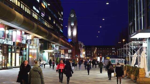 människor går nerför natten upplyst gata - finland bildbanksvideor och videomaterial från bakom kulisserna