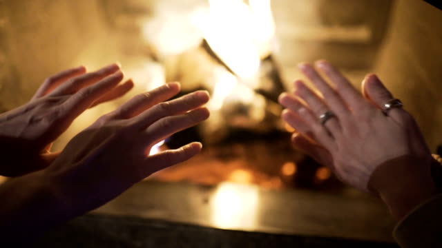 people are warming their hands by the fire at home people are warming their hands by the fire chalet stock videos & royalty-free footage