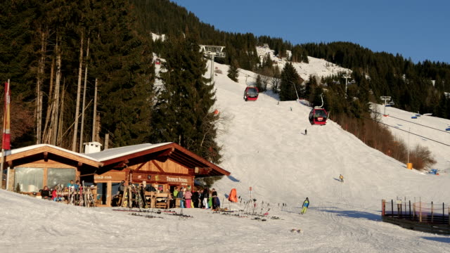 People at a ski resort People skiing at a ski resort chalet stock videos & royalty-free footage