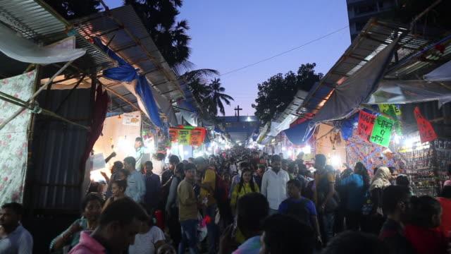 people at mount mary fair in mumbai - ferragosto video stock e b–roll