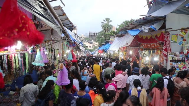People at Mount Mary Fair in Mumbai Wide shot of crowd activities in a local fair market church architecture stock videos & royalty-free footage
