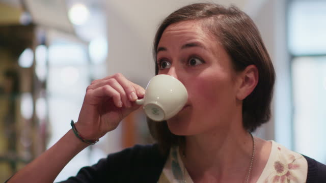People, bar, cafeteria, girl, woman, female client drinking espresso coffee video