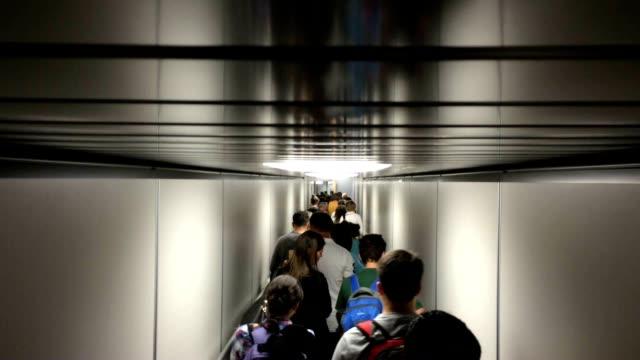 People boarding plane video