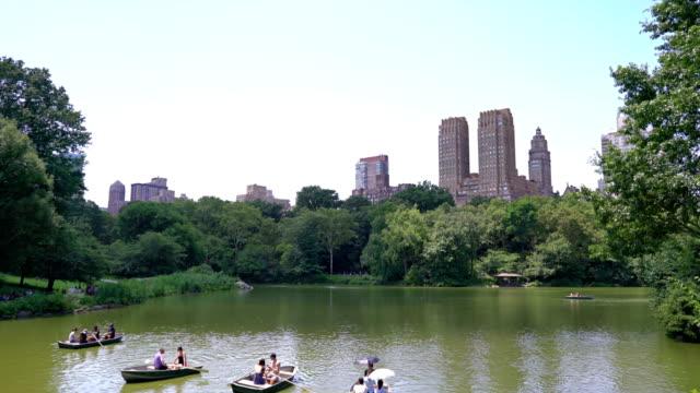 people. boat. relax. central park - staw woda stojąca filmów i materiałów b-roll