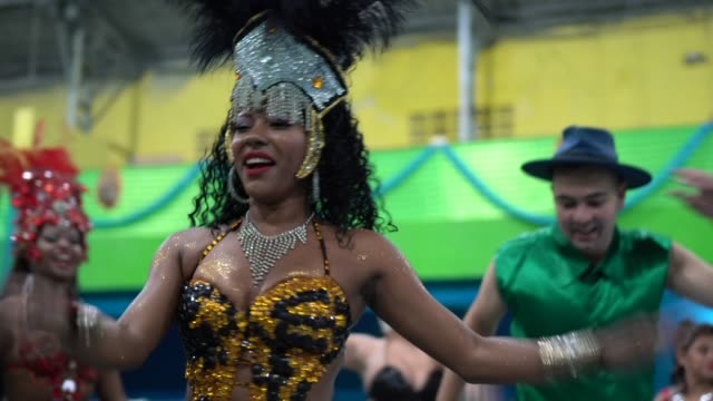 People celebrating and dancing brazilian carnival at school carnival People celebrating and dancing brazilian carnival at school carnival mardi gras stock videos & royalty-free footage