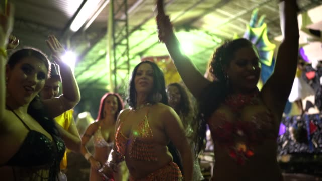People celebrating and dancing brazilian carnival People celebrating and dancing brazilian carnival mardi gras stock videos & royalty-free footage