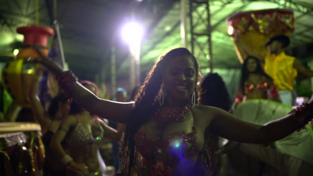 People celebrating and dancing brazilian carnival