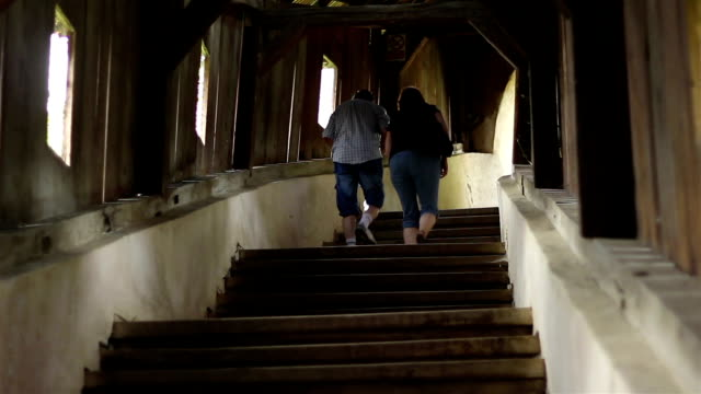 People Climbing Wooden Stairs video