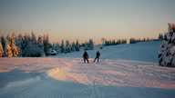 istock SLO MO People cross-country skiing on tracks in the mountains 1302982603