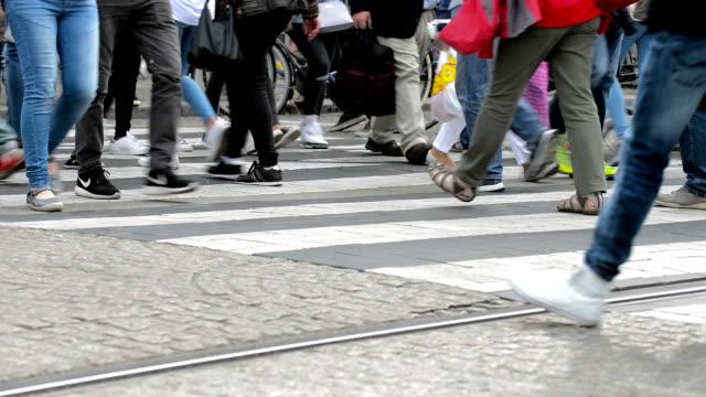 People crossing a busy city crosswalk video