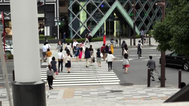 People crossing street in Japan people walking organized group stock videos & royalty-free footage