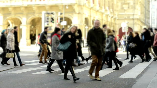 people crossing street. video
