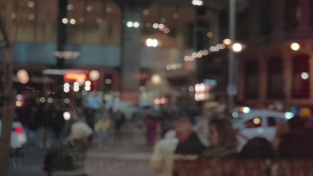 People crossing the street Evening city view through the window Blurred evening city view through the window. Bus passing by and crowd of pedestrians crossing the street bus stock videos & royalty-free footage