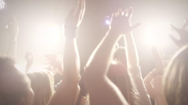 People dancing in disco video