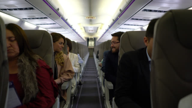 People during a commercial flight some talking others relaxing video