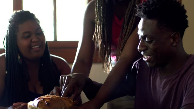 people eating panettone at the dinner table - panettone video stock e b–roll