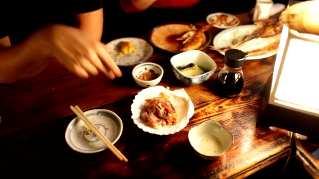 People eating traditional asian food. Above angle of people eating ビデオ