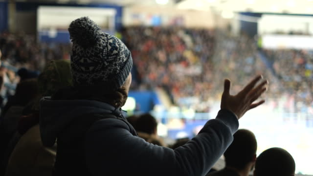 People emotion cheering on stadium hockey close up fan watching sports game 4K. video